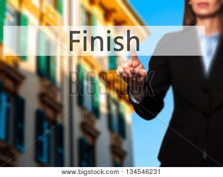 Finish - Businesswoman Hand Pressing Button On Touch Screen Interface.