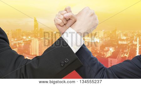 Double Exposure Image Of Business Competitors Doing Arm Wrestling.