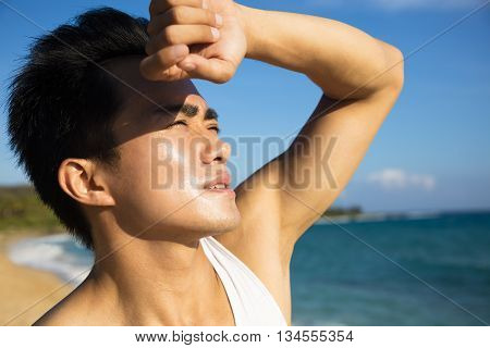 young man under hot summer heat wave