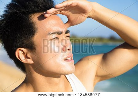 closeup young man face under summer heat wave