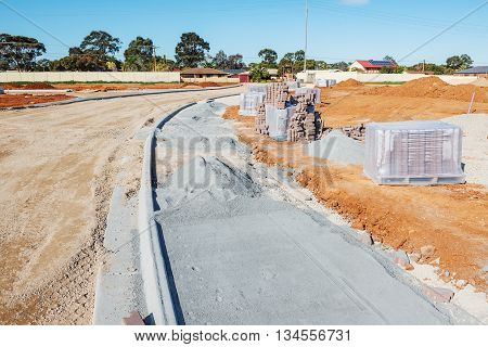 new sidewalk during construction and new plots for homes construction