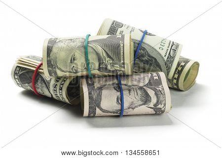 Rolls of US Dollars Lying on White Background