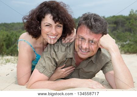 Middle-aged Couple Smiling At The Beach On The Sand