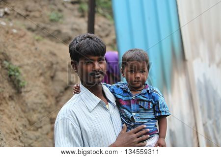 A little boy with his poor father who is a construction worker in India