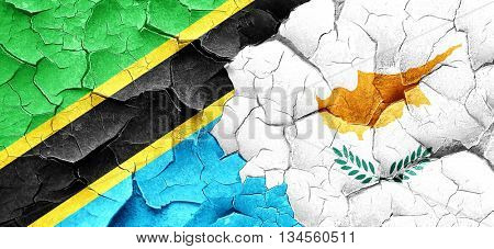Tanzanian flag with Cyprus flag on a grunge cracked wall