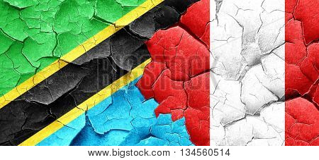 Tanzanian flag with Peru flag on a grunge cracked wall