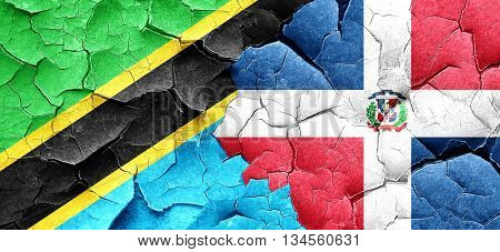 Tanzanian flag with Dominican Republic flag on a grunge cracked