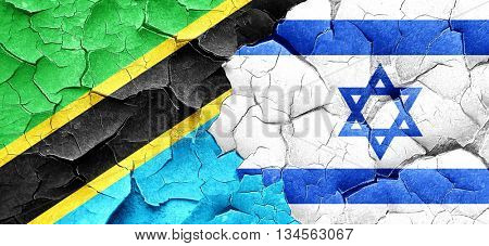 Tanzanian flag with Israel flag on a grunge cracked wall
