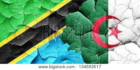 Tanzanian flag with Algeria flag on a grunge cracked wall