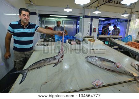 CHANIA GREECE - AUGUST 12: Unknown people sell fresh fish in Chania Crete Greece on 12 August 2014. The cross-shaped market (Agora) of Chania was built in 1911-1913.