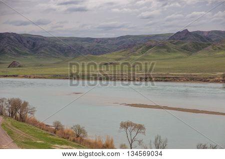 Ili River Kazakhstan, tamgaly tas. Steppe spring