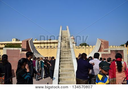 Jaipur India - December 29 2014: People visit Jantar Mantar observatory on December 29 2014 in Jaipur India. The collection of architectural astronomical instruments were built by Sawai Jai Singh II in 1727-1734.