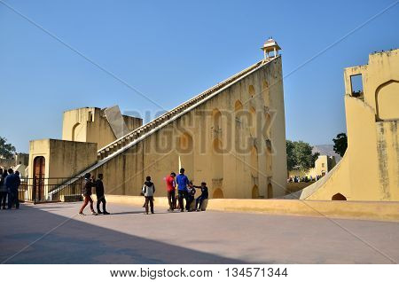 Jaipur India - December 29 2014: Tourist visit Jantar Mantar observatory on December 29 2014 in Jaipur India. The collection of architectural astronomical instruments were built by Sawai Jai Singh II in 1727-1734.