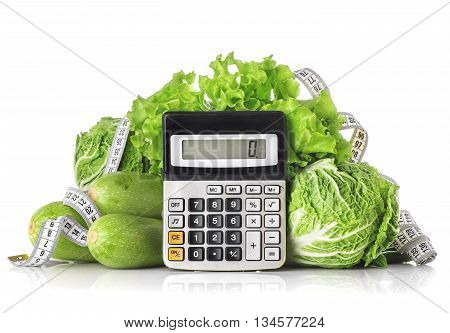 Green vegetables calculator and centimeter isolated on a white background the concept of calories weight loss and healthy diet