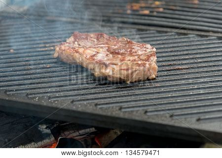 Two t-bone florentine beef steaks on the grill