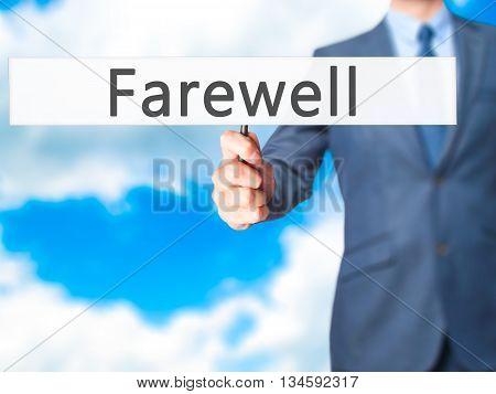 Farewell  - Businessman Hand Holding Sign