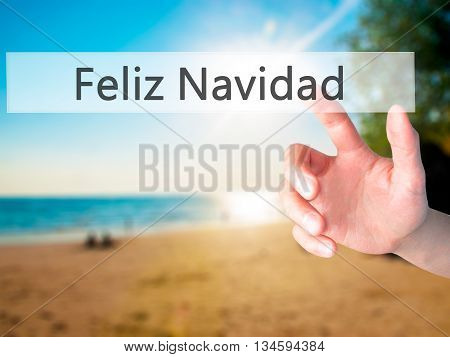 Feliz Navidad (merry Christmas In Spanish) - Hand Pressing A Button On Blurred Background Concept On