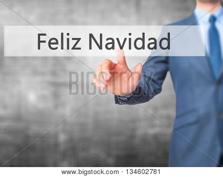 Feliz Navidad (merry Christmas In Spanish) - Businessman Hand Pressing Button On Touch Screen Interf