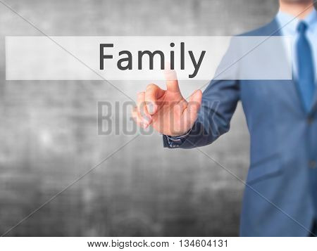 Family - Businessman Hand Pressing Button On Touch Screen Interface.