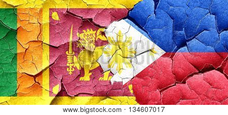 Sri lanka flag with Philippines flag on a grunge cracked wall