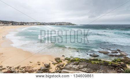 Surging waves from the Tasman Sea break upon a deserted Bondi Beach, New South Wales, Australia.