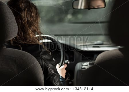 Photo of female car driver traveling by vehicle