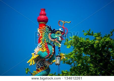 The Statue Of A Dragon On A Pole. Chinese Red Lantern.chinese Temple.
