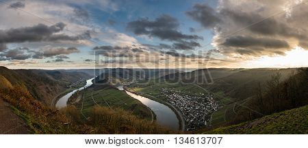 Panoramic view over the Moselle loop near Bremm at sunset with beautiful golden light and clouds
