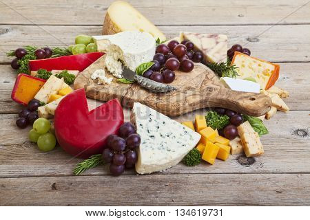 Assorted cheeses on rustic wooden surface