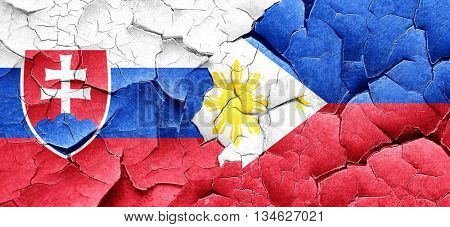 Slovakia flag with Philippines flag on a grunge cracked wall