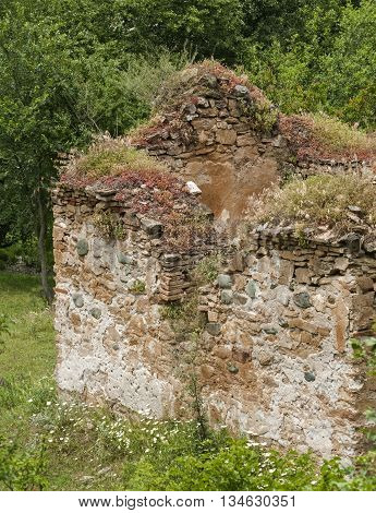 Remnants of demolished abandoned medieval church in forest