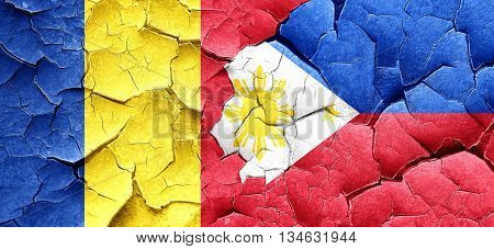 Romania flag with Philippines flag on a grunge cracked wall
