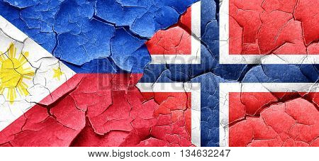 Philippines flag with Norway flag on a grunge cracked wall
