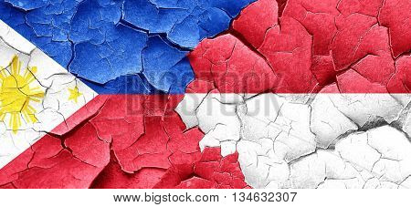 Philippines flag with Indonesia flag on a grunge cracked wall
