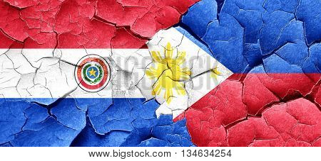 Paraguay flag with Philippines flag on a grunge cracked wall