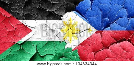 palestine flag with Philippines flag on a grunge cracked wall