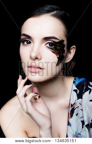 Portrait of pretty woman face with false feather eyelashes fashion makeup poster