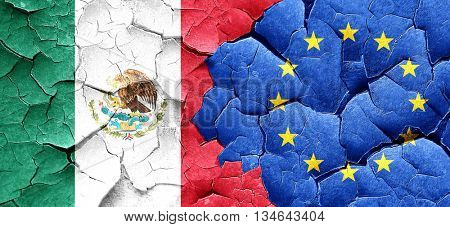 mexico flag with european union flag on a grunge cracked wall