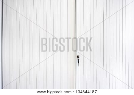 an key in the key lock to an sliding door