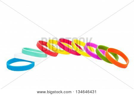 Colored latex bracelets on White Background. Multicolor collage