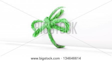 Handmade green rope knot tied on white paper scroll isolated