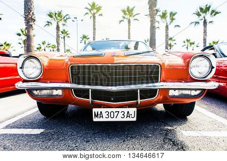 Benalmadena, Spain - June 21, 2015: Front view of classic 1972 Chevrolet Camaro in orange color, parked in Benalmadena (Spain), on June 21, 2015.