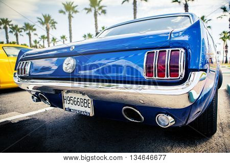 Benalmadena, Spain - June 21, 2015: Back view of classic Ford Mustang in blue color, parked in Benalmadena (Spain), on June 21, 2015.
