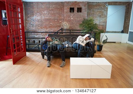 NEW YORK - CIRCA MARCH, 2016: men take a rest in the hostel. Hostels provide budget-oriented, sociable accommodation where guests can rent a bed
