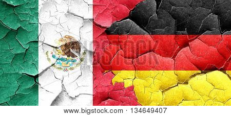 mexico flag with Germany flag on a grunge cracked wall