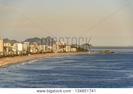 Ipanema beaches and Arpoador seen from above during the evening of Rio de Janeiro on a sunny day