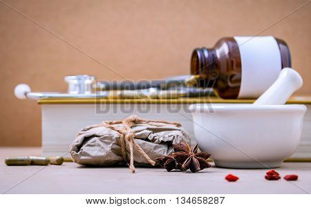 Alternative Health Care Dried Various Chinese Herbs In Wooden Box And Herbs Capsule In Wooden Spoon