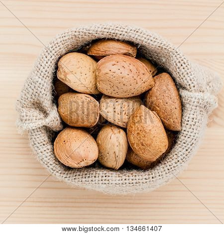 Almonds Kernels And Whole Almonds On Wooden Background. Whole And Chopped Almond On Wooden Backgroun