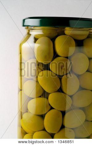 Glass Jar Of Preserved Olives (Horizontal Closeup)
