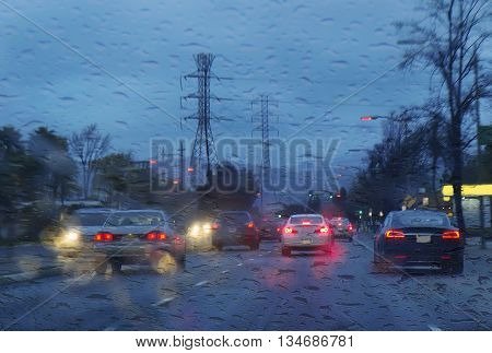 Street with cars in rain. Road view through car window.
